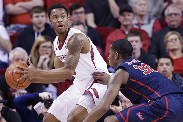 Arkansas' Anthlon Bell, left, looks around Mississippi defender Jarvis Summers, right, is the second half of an NCAA college basketball game in Fayetteville, Ark., Wednesday, March 5, 2014. Arkansas defeated Mississippi 110-80. (AP Photo/Danny Johnston)