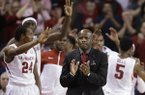 Arkansas coach Mike Anderson, center, claps as members of the Arkansas team celebrate near the end of the second half of an NCAA college basketball game in Fayetteville, Ark., Wednesday, March 5, 2014. Arkansas defeated Mississippi 110-80. (AP Photo/Danny Johnston)