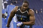 Arkansas defensive lineman Chris Smith runs a drill at the NFL football scouting combine in Indianapolis, Monday, Feb. 24, 2014. (AP Photo/Michael Conroy)