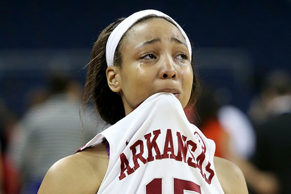 Arkansas guard Kelsey Brooks reacts after Ole Miss defeated Arkansas 63-62 in the first round of the Women's Southeastern Conference NCAA college basketball game, Wednesday, March 5, 2014, in Duluth, Ga. (AP Photo/Jason Getz)