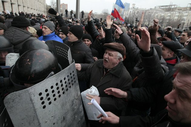demonstrators-break-police-ranks-smashing-their-way-into-the-regional-administrative-building-in-donetsk-ukraine-on-wednesday-march-5-2014-hundreds-of-demonstrators-waving-russian-flags-have-stormed-a-government-building-in-donetsk-in-the-eastern-ukraine-the-region-is-the-home-area-of-fugitive-ukrainian-president-viktor-yanukovych-who-fled-the-country-after-protests-in-kiev