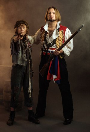 Gavroche (Matthew Hugg, left), and Enjolras (Caleb Reese) prepare for revolution in Arkansas Repertory Theatre's production of Les Miserables.