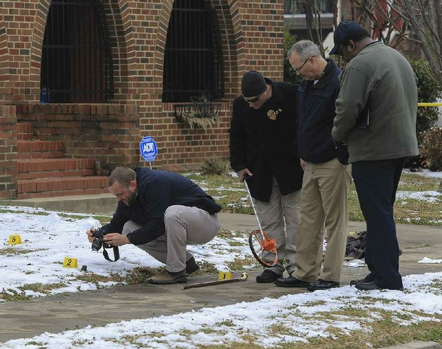 north-little-rock-police-officers-gather-evidence-wednesday-afternoon-at-the-scene-of-an-officer-involved-shooting-in-front-of-first-presbyterian-church-at-the-corner-of-west-fourth-and-maple-streets-in-downtown-north-little-rock-police-say-a-man-causing-a-disturbance-on-a-city-bus-was-fatally-shot-after-being-removed-from-the-bus-and-attacking-an-officer-with-a-wooden-cane