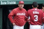 Arkansas coach Dave Van Horn talks with Michael Bernal after he was thrown out at home plate during a game Saturday, March 1, 2014 at Baum Stadium in Fayetteville.