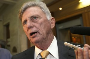 Beebe signs bill to insure poor