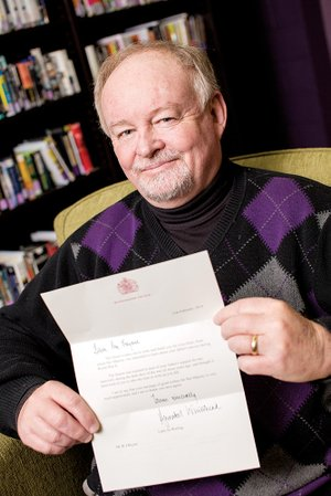 Jimmy Bryant, director of the University of Central Arkansas Archives, holds a letter from Queen Elizabeth II's lady-in-waiting, who wrote on behalf of the queen in response to a letter Bryant sent. He wrote the queen to tell her that his father appreciated her service during World War II. He said the queen was in the Auxiliary Territorial Service.