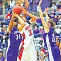 Special to NWA Media Mark Buffalo Tahlon Hopkins of Farmington is surounded Friday by Lonoke's...