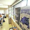 STAFF PHOTO BEN GOFF Posters hang Friday in the windows of a classroom at Fayetteville High School t...