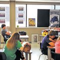 STAFF PHOTO BEN GOFF Posters hang in the windows Friday of a classroom at Fayetteville High School t...