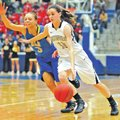Special To NWA Media Mike Kemp Lauren Hargus, Bentonville guard, drives past North Little Rock&#821...