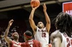 Alabama guard Trevor Releford (12) shoots against Arkansas during an NCAA college basketball game Saturday, March 8, 2014, at Coleman Coliseum in Tuscaloosa, Ala. (AP Photo/AL.com, Vasha Hunt)