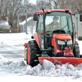 FILE PHOTO JASON IVESTER Michael Thomas, head groundskeeper, scrapes snow and ice from the parking l...