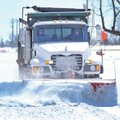 FILE PHOTO ANDY SHUPE A Springdale truck plows 48th Street March 3 after a winter storm brought ice,...
