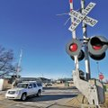 FILE PHOTO BEN GOFF A vehicle crosses railroad tracks that bisect the NorthWest Arkansas Community C...