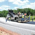FILE PHOTO SAMANTHA BAKER Benton County's Road Department crew lays asphalt June 19 on North T...