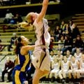 Special to NWA Media Bud Sullins Ashlin Stock, Siloam Springs senior, goes up for the shot Saturday ...