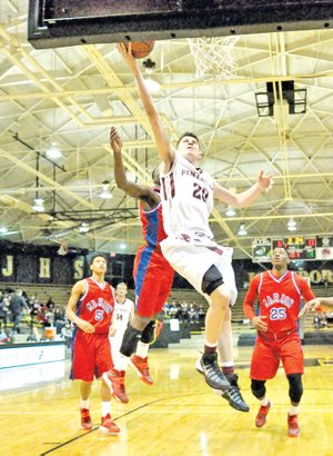 Special to NWA Media Bud Sullins Avery Benson, a Siloam Springs freshman, splits the Marion defense Saturday for a layup during the Panthers' 52-45 win against the Patriots in the Class 6A State Tournament at Jonesboro.