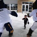Michael Jorski, 4, of Rogers, center, runs up to Sinker the Lake Creature and Strike the Sasquatch S...