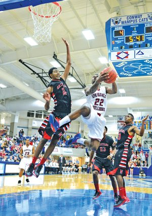 Special to NWA MEDIA Jaison Sterling D.J. Evans of Springdale High soars to the basket Monday against Fort Smith Northside at the Class 7A state tournament in Conway.