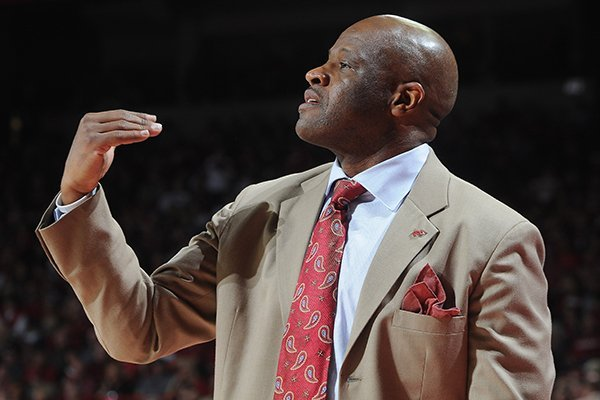 Arkansas' Mike Anderson coaches from the bench Saturday, March 1, 2014, during the second half of the game at Bud Walton Arena in Fayetteville