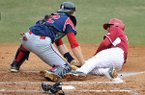 Arkansas base runner Michael Bernal is tagged out by South Alabama catcher Matt Wojciechowski as he tries to score a run in the third inning of the first game of Saturday's doubleheader against South Alabama at Baum Stadium in Fayetteville.