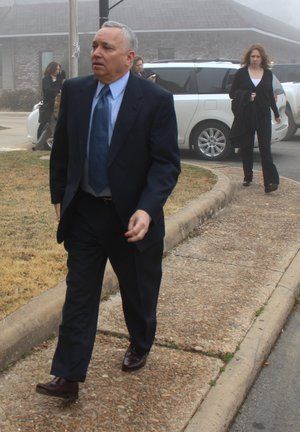 Arkansas Democrat-Gazette/GAVIN LESNICK - 03/10/2014 - Former University of Central Arkansas Chief of Staff Jack Gillean arrives at Van Buren Circuit Court in Clinton Monday before the first day of testimony in his trial.