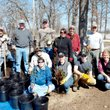 Photo by Randy Moll Planting trees in pots on Thursday to be placed at the SWEPCO tree farm at the Flint Creek Power Plant for planting in the fall were Rita Whiting (front, left), Delia Haak, Ethan Whiting, Lauren Ray, Tim Snell (squatting behind the front row), Terry Stanfill (back, left), Ralph Weber, Scott Carney, Becky Roark, Cody Haak and Rex Barrett.