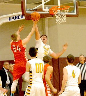 Prairie Grove sophomore Dylan Soehner, shown blocking a shot in the 4A North Regional, became a force in the middle for the Tigers. Soehner scored nine points against Dollarway during the Tigers' 69-43 loss at the State 4A boys basketball tournament on Friday.