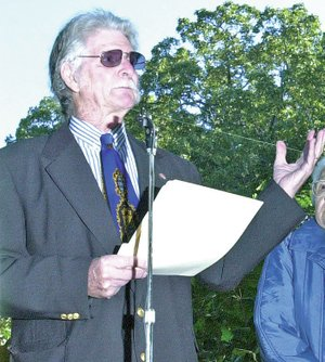 FILE PHOTO Lyell Thompson speaks at a peace pole dedication in 2003 under a patch of post oak trees at Wilson Park in Fayetteville.