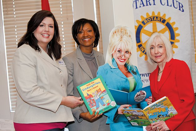 from-the-left-michelle-ford-program-director-for-arkansas-preschool-plus-in-conway-charlotte-green-executive-director-of-arkansas-preschool-plus-and-first-lady-ginger-beebe-stand-with-a-cardboard-cutout-of-singer-dolly-parton-who-founded-imagination-library-to-provide-free-books-for-a-year-to-children-from-birth-to-5-years-old-at-a-conway-rotary-club-meeting-arkansas-preschool-plus-announced-that-it-is-an-imagination-library-affiliate