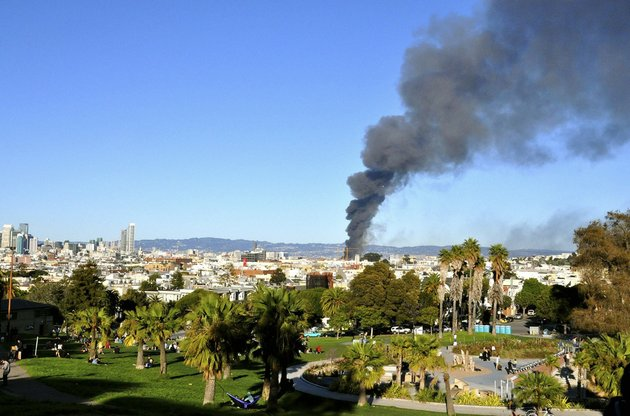 in-this-photo-released-by-danielle-gasbarro-smoke-rises-from-a-fire-as-seen-from-dolores-park-in-san-francisco-on-tuesday-march-11-2014-san-francisco-firefighters-have-prevented-a-major-blaze-from-spreading-from-a-condominium-construction-site-to-nearby-buildings