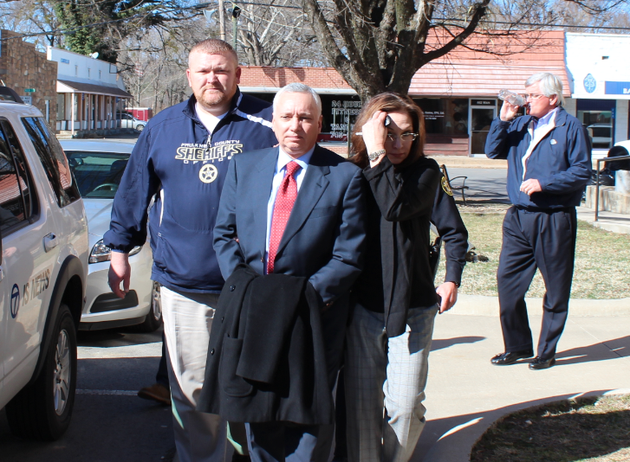 jack-gillean-center-is-escorted-by-authorities-from-the-van-buren-county-courthouse-in-march-2014-after-his-sentencing