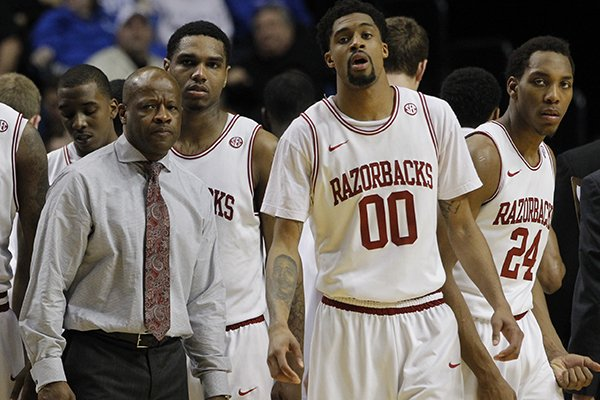 Arkansas coach Mike Anderson and players Ky Madden, Coty Clarke and Michael Qualls react following a loss to Vanderbilt on March 14, 2013 during the first round of the SEC Tournament at Bridgestone Arena in Nashville, Tenn.