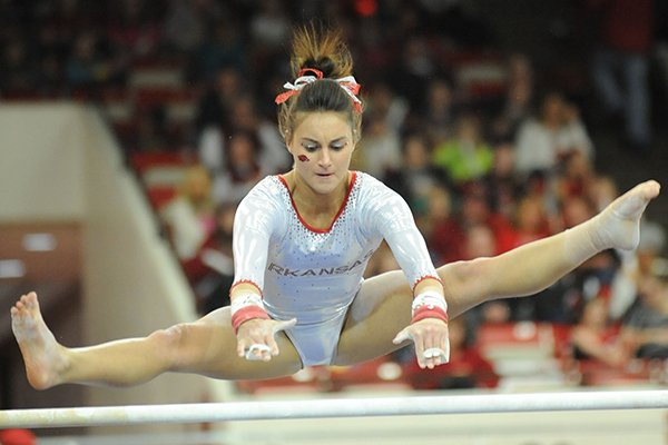 Arkansas' Stephani Canizaro competes in the bars during a meet with Kentucky Friday, Feb. 21, 2014, at Barnhill Arena in Fayetteville.