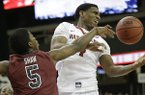 Arkansas forward Coty Clarke (4) and South Carolina guard Jaylen Shaw (5) vie for a loose ball during the first half of an NCAA college basketball game in the second round of the Southeastern Conference men's tournament, Thursday, March 13, 2014, in Atlanta. (AP Photo/Steve Helber)