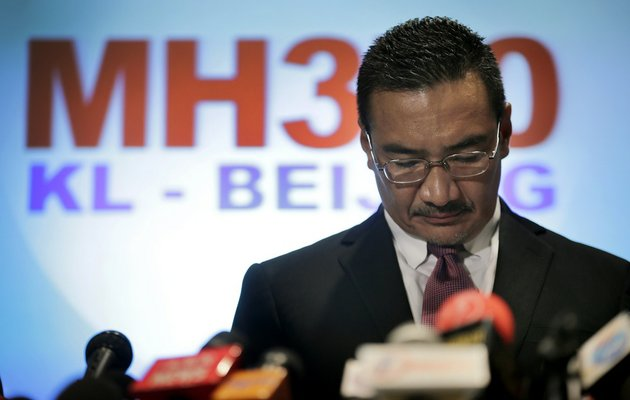 malaysias-minister-of-transport-hishamuddin-hussein-pauses-before-responding-to-queries-from-the-media-about-the-missing-malaysia-airlines-jetliner-mh370-on-thursday-march-13-2014-in-sepang-malaysia