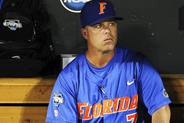 In this June 28, 2011, file photo, Florida coach Kevin O'Sullivan sits in the dugout after South Carolina beat Florida 5-2 in Game 2 of the NCAA baseball College World Series best-of-three finals, to win the title in Omaha, Neb. (AP Photo/Eric Francis)