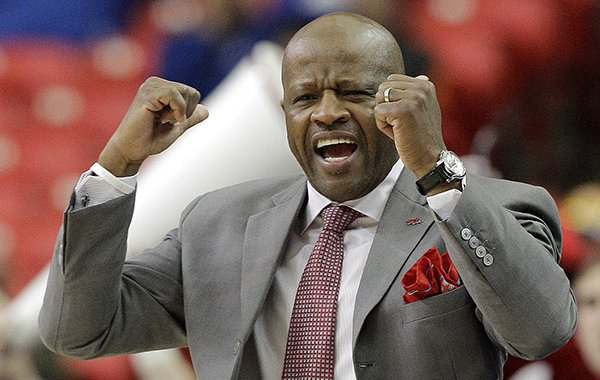 Arkansas head coach Mike Anderson speaks to players against South Carolina during the first half of an NCAA college basketball game in the second round of the Southeastern Conference men's tournament, Thursday, March 13, 2014, in Atlanta. (AP Photo/Steve Helber)