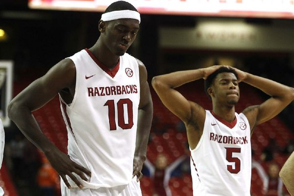 Arkansas Democrat-Gazette/STATON BREIDENTHAL --3/13/14-- Arkansas' Bobby Portis (left) and Anthlon Bell leave the court after their loss to South Carolina Wednesday following their SEC Tournament game at the Georgia Dome in Atlanta.