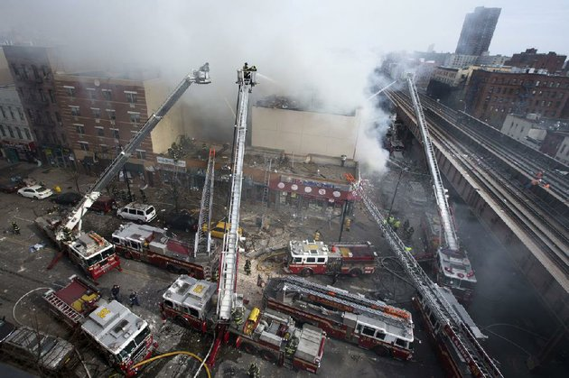 firefighters-battle-a-fire-after-a-building-collapses-in-the-east-harlem-neighborhood-of-new-york-wednesday-march-12-2014-ap-photojohn-minchillo
