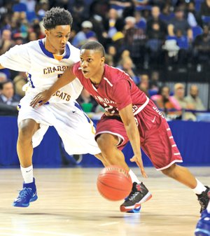 Arkansas Democrat-Gazette RICK MCFARLAND Treyshawn Lackey-Gause of Springdale High drives past North Little Rock's Jawan Eldridge on Thursday at the state Class 7A boys championship game in Hot Springs.