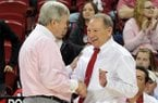 Texas A&M coach Gary Blair (left) and Arkansas coach Tom Collen talk prior to a Jan. 6, 2013 game at Bud Walton Arena in Fayetteville.