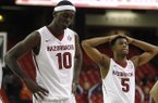 Arkansas' Bobby Portis (left) and Anthlon Bell leave the court after their loss to South Carolina Wednesday following their SEC Tournament game at the Georgia Dome in Atlanta.