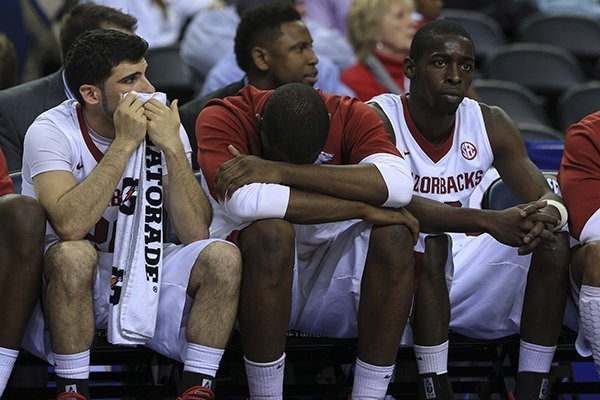 Arkansas' Kikko Haydar (left), Manuale Watkins (middle) and Fred Gulley III watch the closing seconds or their loss to South Carolina at the SEC Tournament at the Georgia Dome in Atlanta.