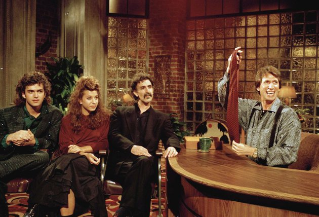 file-in-this-sept-24-1986-file-photo-comedian-david-brenner-hosts-avant-garde-fusion-musician-frank-zappa-center-and-his-children-dweezil-left-and-moon-unit-during-a-taping-of-brenners-nightlife-talk-show-in-new-york-brenner-holds-a-necktie-given-to-frank-zappa-upon-entering-a-restaurant-earlier-in-the-day-on-saturday-march-15-2014-publicist-jeff-abraham-announced-brenner-has-died-at-the-age-of-78