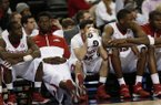 Arkansas players sit on the bench during the second half of an NCAA college basketball game against South Carolina in the second round of the Southeastern Conference men's tournament, Thursday, March 13, 2014, in Atlanta. (AP Photo/John Bazemore)
