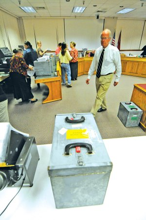 FILE PHOTO John Logan Burrow, who served as chairman of the Washington County Election Commission since 1995, oversees the counting of ballots in the 2010 general election at the Washington County Courthouse. Burrow died unexpectedly from a heart attack last week.