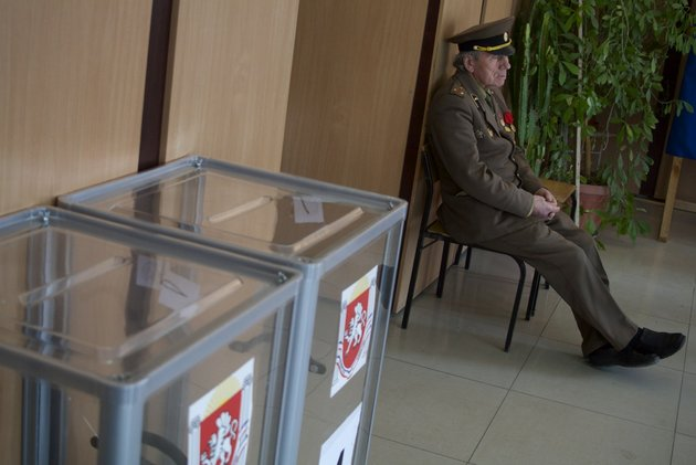 an-election-observer-sits-at-a-polling-station-in-simferopol-ukraine-on-sunday-march-16-2014-residents-of-ukraines-crimea-region-are-voting-in-a-contentious-referendum-on-whether-to-split-off-and-seek-annexation-by-russia