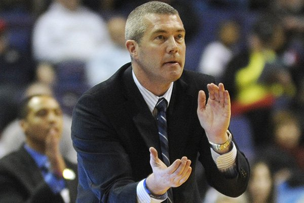 Indiana State coach Greg Lansing cheers his team near the end of the game against Southern Illinois in an NCAA college basketball game in the semifinals of the Missouri Valley Conference men's tournament, Saturday, March 8, 2014, in St. Louis. (AP Photo/Bill Boyce)
