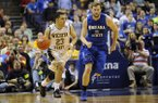 Wichita State's Fred VanVleet (23) drives past Indiana State's Jake Kitchell (0) in an NCAA college basketball game in the championship of the Missouri Valley Conference men's tournament, Sunday, March 9, 2014, in St. Louis. (AP Photo/Bill Boyce)